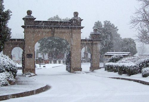 Photo of entrance to Springwood Cemetery, covered in snow after a winter storm