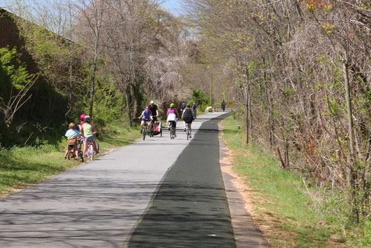 People walking and running on the Swamp Rabbit Trail