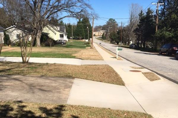 Photo of new sidewalk after installation on a city street